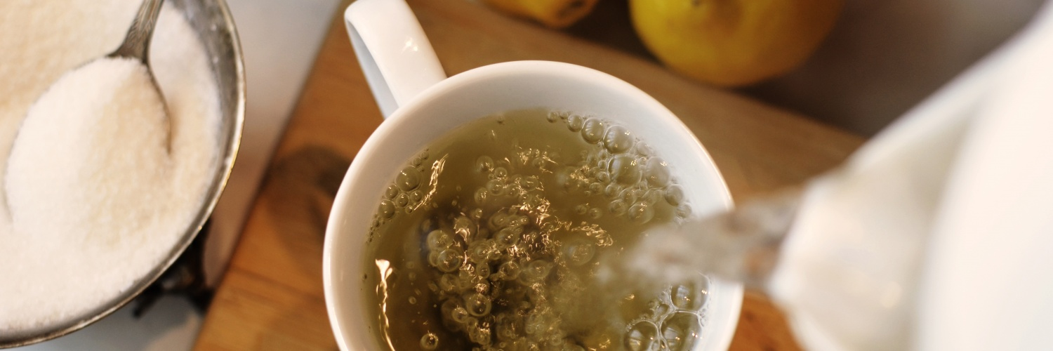 An overview shot of tea being poured into a cup