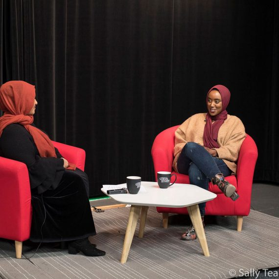Eman bare being interviewed by writer; Haazifah