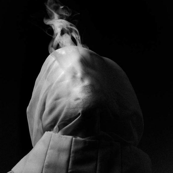 Image of a subject with a cloth wrapped around their head.